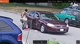 Suspect opening door of get away car